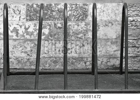 the free parking for bicycles from metal closeup of monochrome tone
