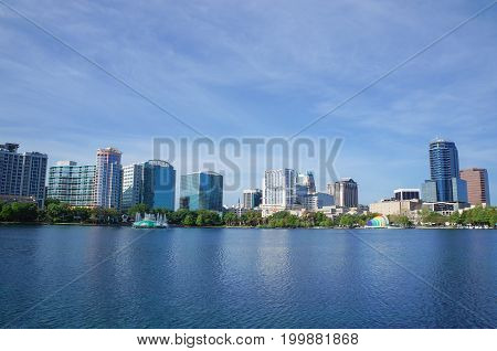 Lake Eola, High-rise buildings, skyline, and fountain Downtown Orlando, Florida, United States, April 27, 2017.