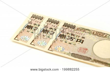 Japanese bank note 10000 yen on white background