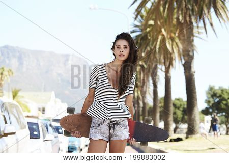 Young cool Skateboard babe on boulevard portrait