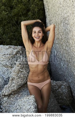 Young Gorgeous bikini babe smiling to camera