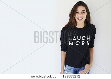 Young Laughing brunette in slogan sweatshirt portrait
