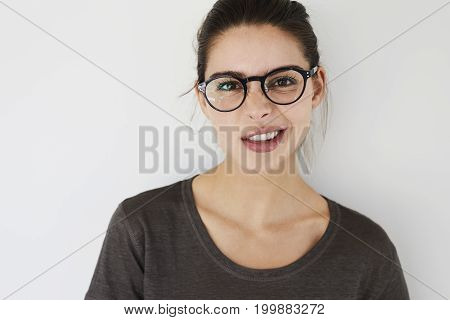 Young cheeky woman pulling disbelieving face portrait