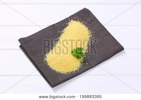 pile of raw couscous on grey place mat