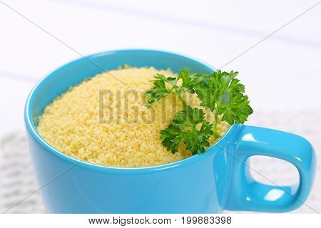 cup of raw couscous - close up