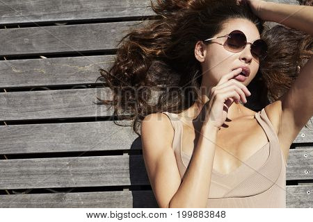 Young Sensuous babe in swimsuit and shades