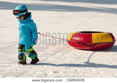 Little Boy With Snow Tube, White Background. Color Image.