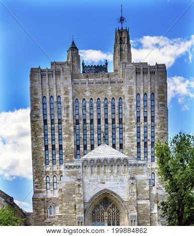 NEW HAVEN, CONNECTICUT-JUNE 24, 2017 Yale University Sterling Memorial Library Statue New Haven Connecticut Fifth largest library in the United States