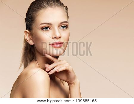Perfect young girl with natural make-up. Photo of girl european appearance on beige background. Youth and skin care concept