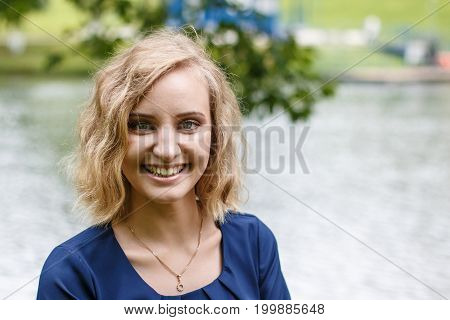 Portrait Attractive Girl With Blond Hair In A Park