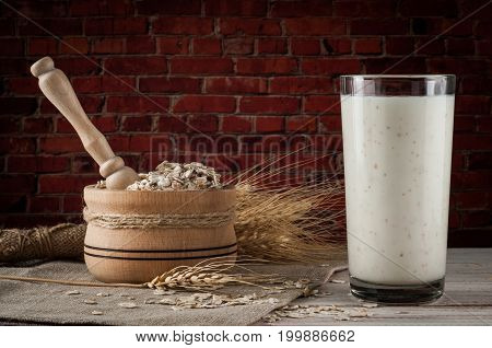 Fresh dairy products and wheat on rustic wooden background. Organic farming dairy concept.