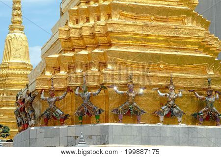 Demon Guardian/ Giant Statues Stand Around Pagoda And Hand To Lift The Base Of The Golden Pagoda Of