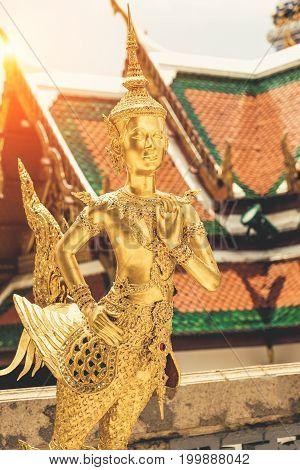 Golden Angel Statue Of Temple Of The Emerald Buddha (wat Pra Kaew) And Grand Palace ,bangkok,thailan