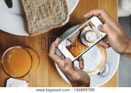 Taking food photo, food photography by smart phone, morning meal with hot coffee