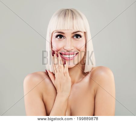 Beauty Portrait of Happy Surprised Woman. Smiling Model with Makeup Manicure Blonde Hair and Cute Smile