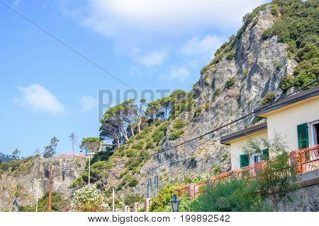 Daylight view from bottom to mountains and blue sky. Monterosso al Mare, Italy, Cinque Terre.