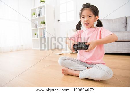 Happy Little Daughter Focus On Using Game Joystick