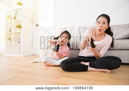 Daughter And Beautiful Mom Sitting On Living Room