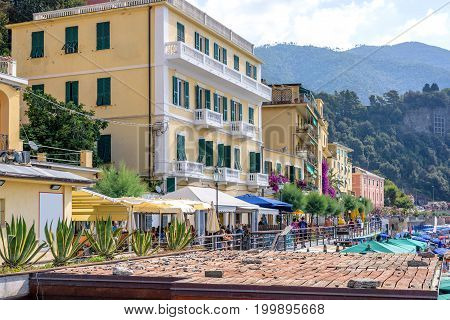 Daylight view to Monterosso al Mare mountains and beachline streets with buildings. Italy, Cinque Terre