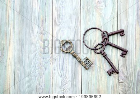 Vintage metal keys on a wooden background closeup