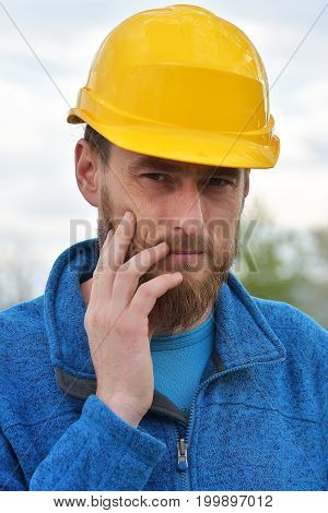 Happy Confident Bearded Young Man In Helmet