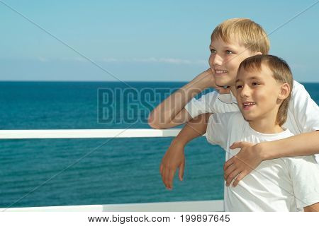 Two brothers sitting in yacht in open sea