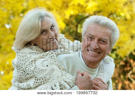 Portrait of a happy senior couple hugging outdoors