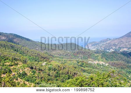 Beautiful landscape daylight view to green mountains and blue sea of Monterosso al Mare in Italy. Cinque Terre beauties