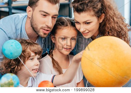 Family Exploring Solar System Model For School Project