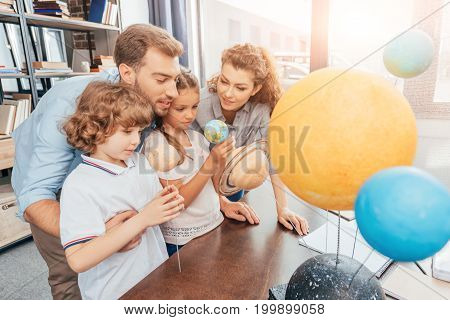 Young Interested Family Making Solar System Model