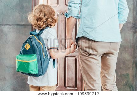 Rear View Of Dad And Son Going To School