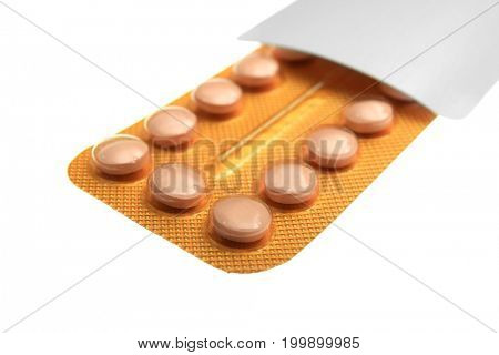 Strip of oral contraceptive pills on white background