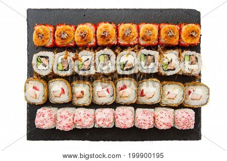 Big Set Of Sushi Roll On Slate. Japanese Food Restaurant. Dark Background. Top View