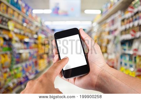 Person Using Smartphone White Screen Holder On Hand With Shelves On Background In Supermarket.