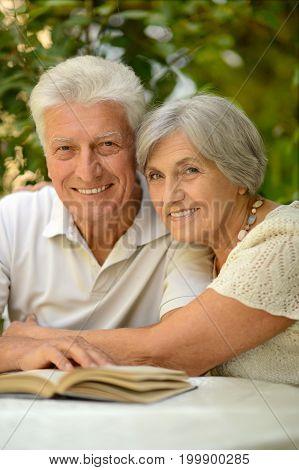 Portrait of a senior couple reading a book