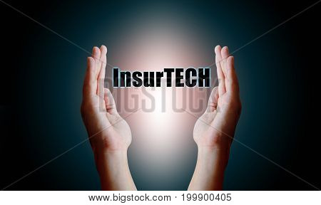 Insurance technology (Insurtech) concept Human hand holding and protect text with virtual screen on back blackground.