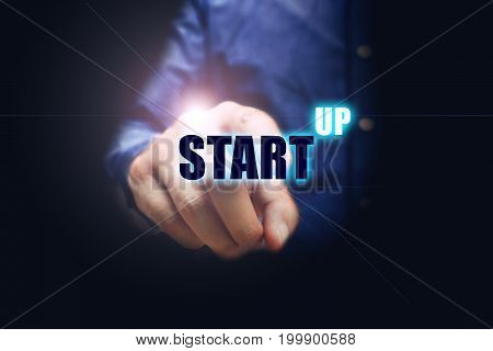 Hand man pointing the virtual letter start-up text with business trend concept.
