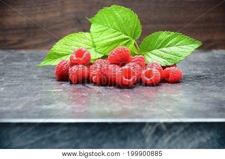 Raspberry on black background close up photo