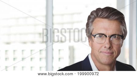 Digital composite of Business man standing against white blurred background