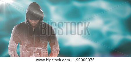 Spy in black hoodie against abstract pattern on wall