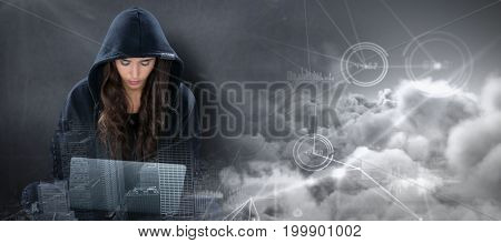 Young female hacker using laptop while sitting  against composite image of interface connecting lines over clouds