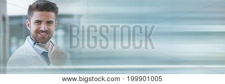 Digital composite of Doctor man holding glasses