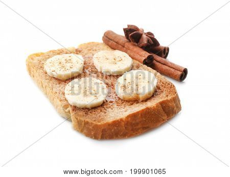 Tasty cinnamon toast with sliced banana on white background