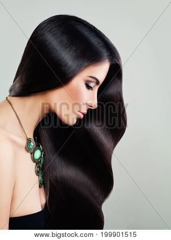 Perfect Woman with Long Healthy Hair and Makeup. Beautiful Girl Haircare and Beauty Salon Background