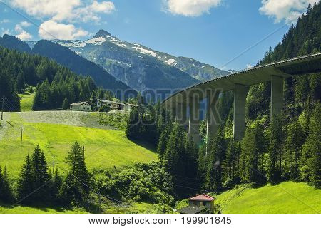 Background view of the mountain peaks of the Alps and high-speed road in the mountains near Bolzano