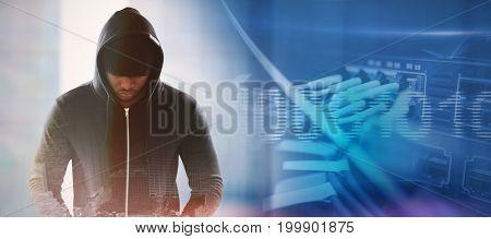 Spy in black hoodie against composite image of binary code on digital screen