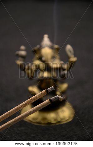 Ganesha on black background close up photo