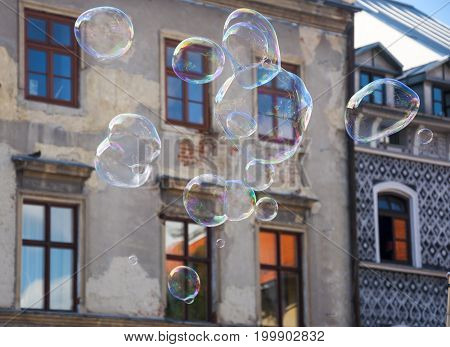 sopa bubbles floating over old town houses