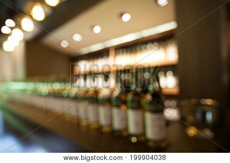 Abstract Background Blur Of Whisky Bar For Adult Party On Restaurant.