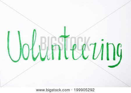 Word VOLUNTEERING on white background